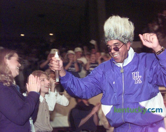 "University of Kentucky men's basketball coach Tubby Smith entered Memorial Coliseum Oct. 16, 1998 dressed as boxing promoter Don King as part of the Midnight Madness ""Main Event."" The 17th annual Midnight Madness, which signals the start of the team's practice, drew its usual capacity crowd of 8,700. The coach of the national defending champions said he was nervous because he felt like anyone else in the stands - not knowing how his team will do this year. Photo by Janet Worne 