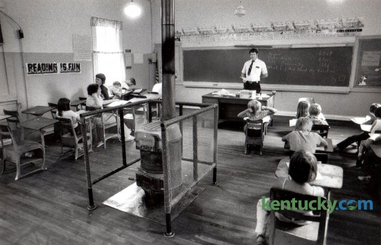 Teacher Meredith Slone surveyed his 18 pupils at Daniels Creek School in Banner, Ky., Tuesday, August 24, 1982. Daniels Creek School, which began its 59th school year the day before, was one of only three one-room schools remaining in Kentucky at the time. The school offered grades one through eight. The school was closed at the end of the 1986-87 school year.  Photo by Charles Bertram | Staff
