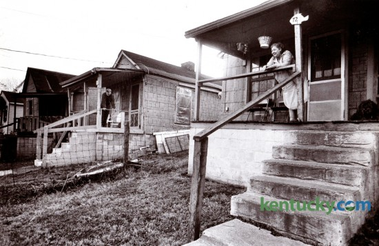 Bill Huddleston, left, and his sister Elizabeth Wardle, right,  lived next door to each other in Davis Bottom in 1980. At the time they were paying $85-a-month rent in the low-income community tucked between South Broadway and West High Street. In 2006 the 29 homes in Davis Bottom were torn down to make way for the Newtown Pike Extension. After eight years of work on the infrastructure the first of fourteen affordable housing units for families displaced by the project were dedicated Thursday November 20, 2014, and called Davis Park View.  Photo by Ron Garrison   Staff