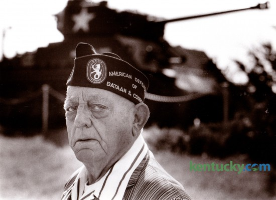 """In November of 1984 Maurice """"Jack"""" Wilson, a former POW in World War II stood in from of a U.S. Army tank in Harrodsburg, which was similar to the ones in his battalion in the Philippines. The tank was donated by the Army as a war memorial to the Mercer County men that served in the 38th Tank Company, Kentucky National Guard from Harrodsburg. His Guard unit was combined with other Guard units to form the 192nd Tank Battalion stationed at Ft. Knox. Wilson and others in his company were captured in 1941 by the Japanese and spent the entire war in a prison camp in Japan. Wilson died in May of 1985. Photo by Ron Garrison 