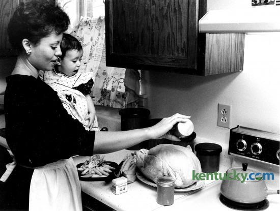Sandra Ashley-Johnson and her daughter Leah prepare a turkey for Thanksgiving Nov. 24, 1985. Photo by Tom Woods | staff