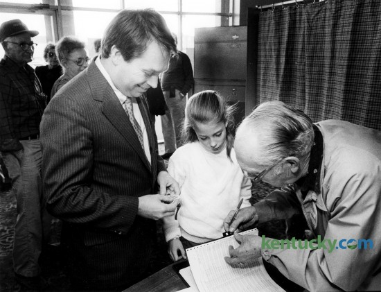 Nine-year-old Alison Lundergan joined her father, Kentucky 76th district representative Jerry Lundergan, as he prepared to sign-in to vote at the Eastland precinct Nov. 8, 1988. Photo by Charles Bertram | staff