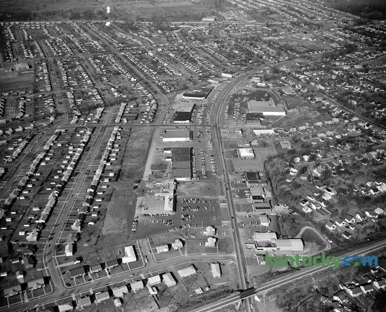 Aerial photo of Southland Shopping Center in Lexington, Jan. 1961. Running up the middle of the picture is Southland Drive and from left to right across the top is Harrordsburg Road. The farm land across the top would later be the site of Turfland Mall.