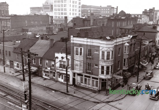 This 1947 view of what is now the CentrePointe block was used to illustrate several buildings that were going to be demolished to make way for a new Woolworth store. Five buildings in this block, including four of the six shown here facing what was then Water St, foreground, were torn down to make room for Woolworth, which fronted on Main St. South Limestone is seen at the right side of this photo. Published in the Lexington Leader April 3, 1947.