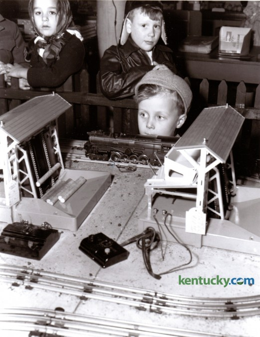 Robert Rodgers, 4, son of Mr. and Mrs. R.G. Rodgers of Addison Ave in Lexington looked at a model train display during the Christmas season, December 1947. Published in the Lexington Herald December 24, 1947.