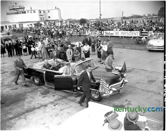 President Dwight Eisenhower (seated in rear of car with his wife Mamie) and his motorcade left Blue Grass Airport Oct. 1, 1956 after arriving to campaign for his re-election. After being meet at the airport by Kentucky Gov. Happy Chandler, the president's car rode through downtown in a parade. He later gave a speach at Memorial Colesium at the University of Kentucky.