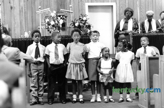 Children of the Bethel Baptist Church congregation sang during Sunday worship services June 22, 1986. Photo by John C. Wyatt | Staff