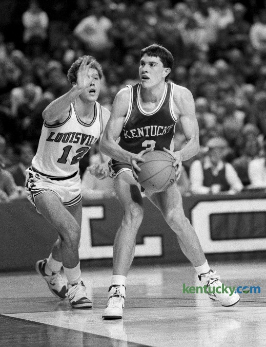 Kentucky basketball player Rex Chapman drove past Louisville's Craig Hawley during the Cats 85-51 win Dec. 27, 1986 in Louisville. Chapman, a freshman,  lit the Cards up for 26 points, hitting 10 of his 20 shot attempts. Despite playing only two years at Kentucky, Chapman is 50th on UK's all-time scoring list with 1,073 points. In 1988 he was drafted eighth overall by the Charlotte Hornets. Photo by Tim Sharp | Staff