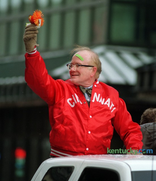 """Actor Richard Sanders prepares to throw a turkey during the Lexington Christmas Parade Saturday, Dec. 6, 1997. He is better known as Les Nessmann from the TV show """"WKRP in Cincinnati"""". He was doing his famous 'turkey drop' that was part of an esisode of the show. The 2014 Lexington Christmas parade is 7 p.m. Tuesday, Dec. 2. Photo by Charles Bertram 
