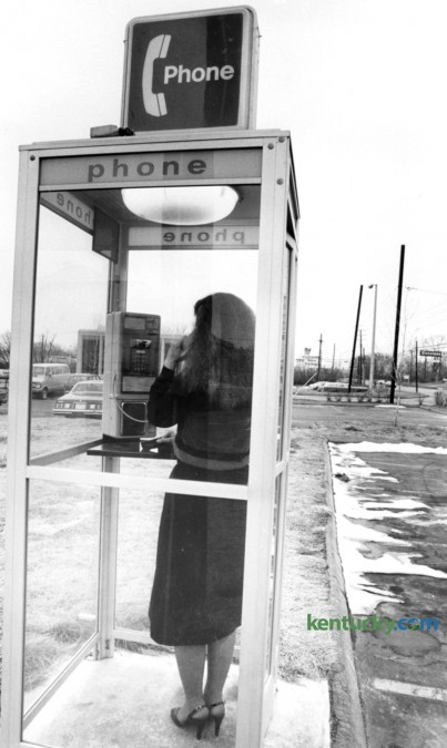 A woman uses a telephone booth March 1981 on Richmond Road in Lexington. Photo by Frank Anderson | staff
