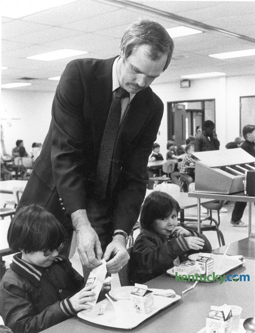 George McKenzie, principal at Ashland Elementary School in Lexington,  helped a student open his cereal box on April 15, 1985. McKenzie arrived at the school that morning to see a banner proclaiming him outstanding principal for the 7th PTA District. Photo by John C. Wyatt | staff