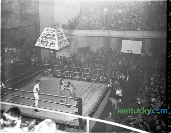 Al view of the ring and crowd during the George Johnson, Willard Huddleston fight, Feb. 3, 1948 during the Herald-Leader Golden Gloves tournament at Woodland auditorium. The auditorium, showcasing everything from professional wrestling to piano performers on the classical music circuit, was built about the turn of the century. It was condemned for public use in 1952 and was torn down sometime in the 1970s. It stood near the corner of East High Street and Kentucky Avenue. Herald-Leader Archive Photo