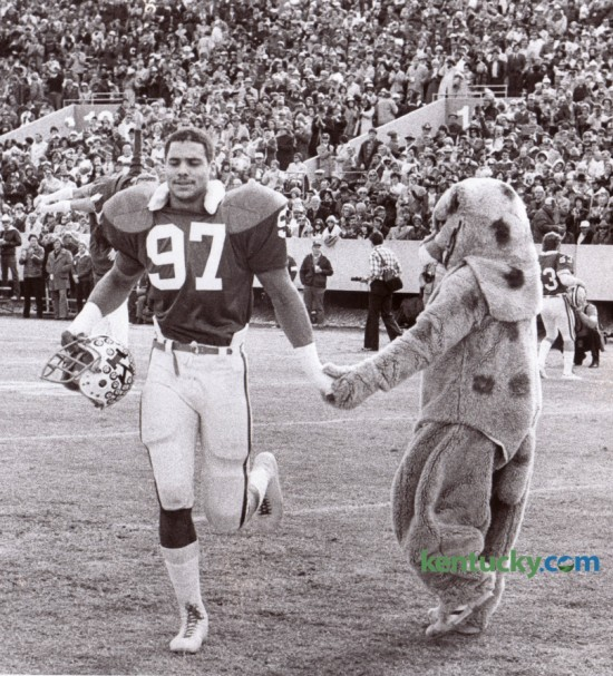 The Wildcat mascot greeted UK's Art Still as the 6-foot-7 defensive end took the field against Tennessee in his final college game November 30, 1977 at Commonwealth Stadium. Kentucky won 21-17. Still was the second overall player taken in the 1978 NFL Draft and played for the Kansas City Chiefs (1978–1987) where he was a 4-time Pro Bowl selection. Following the 1980-1982 and 1984 seasons, he named the Kansas City Chiefs's Most Valuable Player twice (1980 and 1984). He finished his pro career with the Buffalo Bills (1988–1989). Photo by David Perry | Staff