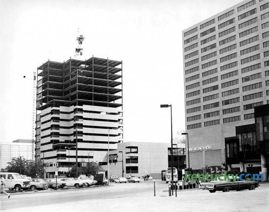 Construction of Kincaid Towers in downtown Lexington June 1978. The 22-story building was was finished in 1979 at a cost of $20 million. For eight years it was the talest building in Lexington. At right is the Hyatt Regency Hotel. Note at left is a parking lot that would later become Triangle Park. The fountain would run along the row of cars parked in this picture. Phot by E. Martin Jessee | staff