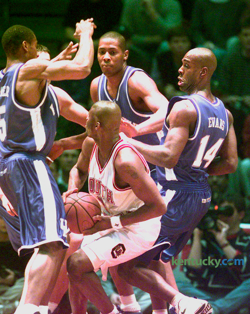 South Carolina's B.J. McKie was surrounded by UK's Wayne Turner, left, Jamaal Magloire and Heshimu Evans during Kentucky's game against the Gamecocks in Columbia, South Carolina January 5, 1999. UK won 68-61. UK was coached by Tubby Smith in his second year and the team finished ranked 8th in the country by AP. The team lost to Michigan State in the Midwest Regional in St. Louis. Photo by Frank Anderson   Staff