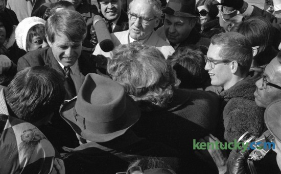 Sen. Robert F. Kennedy, left, shook hands with supporters after arriving at Blue Grass Field February 13, 1968, before beginning a two-day tour of poverty areas in Eastern Kentucky. Kentucky's U.S. senator John Sherman Cooper, center, met Kennedy at the airport. Published in the Lexington Leader February 13, 1968.