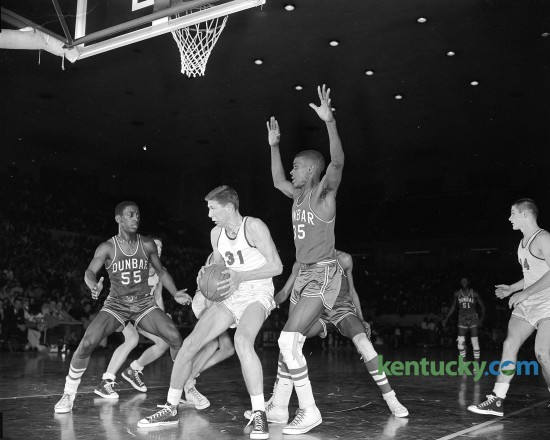 Lafayette's Jeff Mullins is surrounded by Dunbar's James Young and Felix Scruggs during the 11th regional high school basketball tournament in March, 1959. Dunbar won the game, 54-48. Published in the Herald-Leader March 14, 1959. Herald-Leader Archive Photo