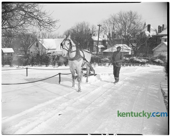 John Harris and Dan, his 10-year-old horse, used a snow plow to clear a drive at Transylvania College in February of 1947. Published in the Lexington Leader February 4, 1947. Herald-Leader Photo Archive