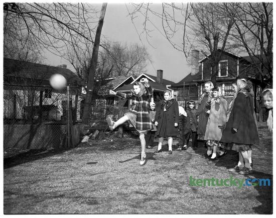 Girls playing kickball at Maxwell Street school, 474 East Maxwell Street. Published in the Herald-Leader February 13, 1949.