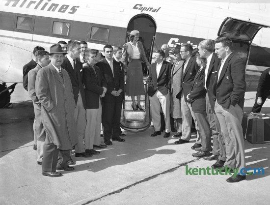 University of Kentucky (UK) basketball team arrived at Blue Grass Field March 2, 1954, after completing the regular season without a defeat.  The traveling party for the two-game trip to Auburn and Alabama included (not in order) Assistant Coach Harry Lancaster, Bill Bibb, Linville Puckett, Cliff Hagan, and Frank Ramsey, Peggy York (center, hostess for Capital Airlines), Gayle Rose, Coach Adolph Rupp, Bill Evans, Student Manager Mike Dolan, Willie Rouse, and Dan Chandler, Harold Hurst, Phil Grawmeyer, Hugh Coy, Sports Publicist Ken Kuhn;, Athletic Director Bernie Shively and Lou Tsioropoulos. Published in the Lexington Leader March 2, 1954.