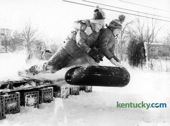 Tyler Callihan, Eddie Hightower and John Piper rode an innertube over a jump they made on a hill behind Lansdowne Shopping Center in Lexington, February 1979. Photo by Charles Bertram | staff