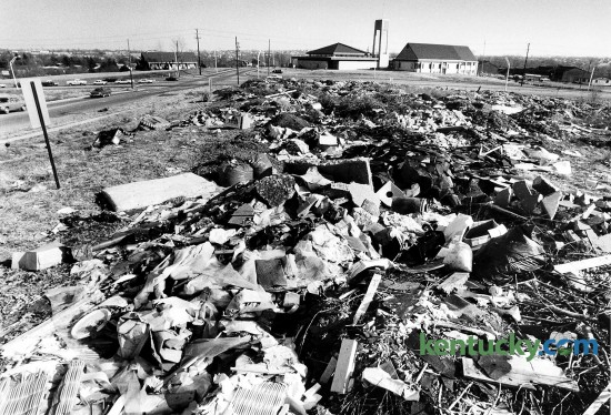 An illegal dump site Feb. 9, 1984 at the corner of Tates Creek and Redding Roads in Lexington. Tates Creek Road runs left to right across the top of the picture. The site is now a Fifth Third Bank branch and a Cheddar's Casual Café. Photo by Charles Bertram | staff