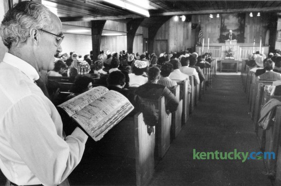 Usher Jerry Cassidy followed along in his bible as Reverend Al Gormley delivered his sermon at Bryan Station Baptist Church February 16, 1986. Photo by Gary Landers