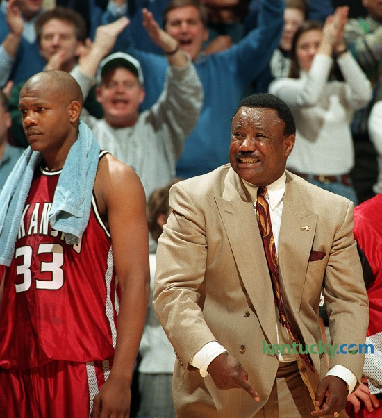 """Arkansas coach Nolan Richardson reacts to an officals call Feb. 11, 1996 durning the second half of Kentucky's 88-73 win over the Razorbacks. The second-ranked Wildcats utilized a deep bench and improved to 20-1 overall and 10-0 in the Southeastern Conference. Richardson, who's Arkansas team won the NCAA title two years ealier, was known for coaching teams that played an fast-paced game with pressure defense - a style that was known as """"40 Minutes of Hell."""" Photo by Frank Anderson   staff"""