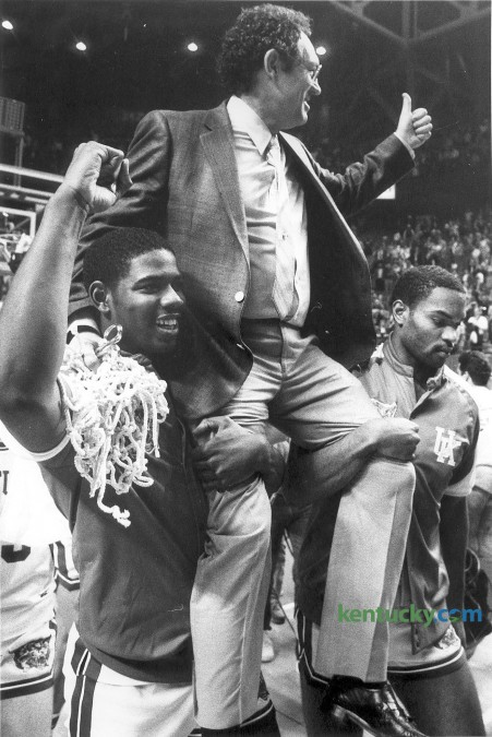 Kentucky basketball coach Eddie Sutton is carried off the court  by Richard Madison, left, and Winston Bennett following the Cats'  March  8, 1986 victory over Alabama, 83-72 in the finals of the SEC tournament at Rupp Arena in Lexington. Rupp Arean has hosted the conference tournament three times; 1982, 1986 and 1993. The Wildcats won two of those tournaments, only losing in the 1982 tourney finals by two points to Alabama. Photo by Charles Bertram | staff