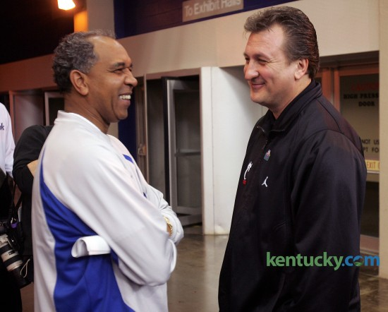 University of Kentucky basketball coach Tubby Smith, left, jokes around with Cincinnati coach Bob Huggins before the Wildcats took the floor for practice March 16, 2005 at the RCA Dome in Indianapolis. Three days later after beating Eastern Kentucky in the first round, Kentucky won it's second-round matchup against Huggins' Bearcats, 69-60. The Wildcats would later lose in the regional finals to to Michigan State in double overtime. Photo by Mark Cornelison | staff