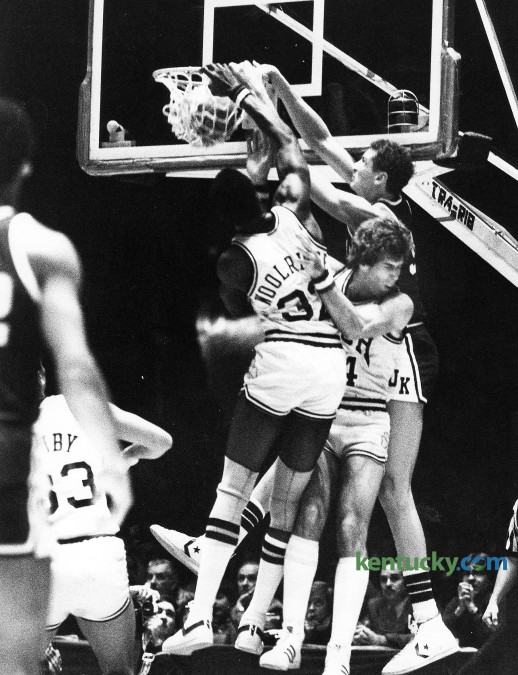 Kentucky's Sam Bowie dunks over Notre Dame's Orlando Woolridge, left, and Kelly Tripucka Dec. 27, 1980 at Freedom Hall in Louisville. Bowie led UK with 18 points but it wasn't enough as the eight-ranked Irish won, 67-61 behind Tripucka's 30 points and Woolridge's 15. It was the first defeat of the year for the No. 2 ranked Wildcats, who would go on to finish the season with two consecutitive losses en route to a 22-6 record. Photo by E. Martin Jessee   staff