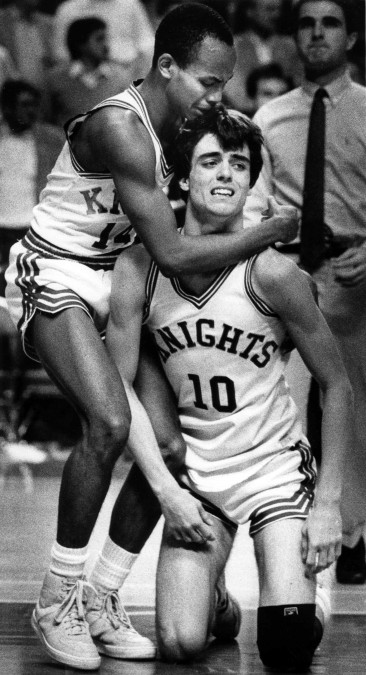 Lexington Catholic players Mike Mitchell and Danny Johnson (10) react to loos to Mason County in the boy's Sweet 16 Tournament in 1985 in Rupp Arena. Photo by Ron Garrison | staff