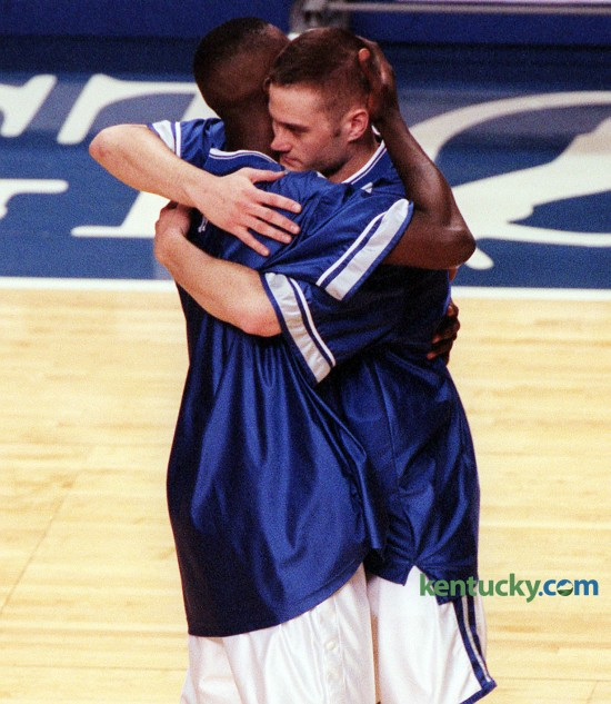 Kentucky basketball's Cameron Mills, right, hugs fellow senior Allen Edwards after the Senior Day ceremony before the team's last home game vs. Georgia Sunday, Feb. 22, 1998 at Rupp Arena in Lexington. UK won the game, 85-74, with Edwards being one of five Wildcats in double figures. Edwards finished his career with 819 points. Mills wrapped up his UK years with 365. Photo by Michelle Patterson-Thomas