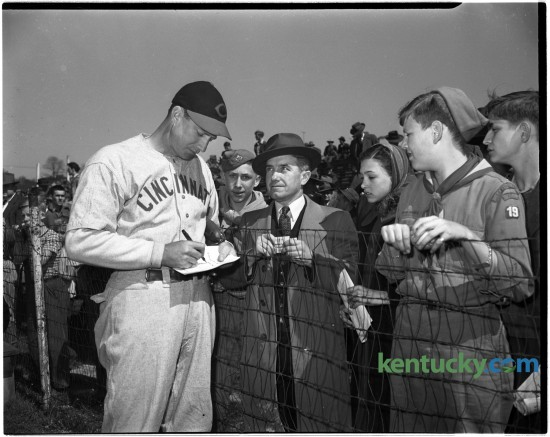 A Cincinnati Red signed autographs before an exhibition game between the Cincinnati Reds and Boston Red Sox at the University of Kentucky's Stoll Field baseball diamond, April 9, 1946.  It was the first game ever played here by two major-league teams.  The training season exhibition title was taken by Cincinnati 4-2.  The crowd was estimated at 7,000-8,000.