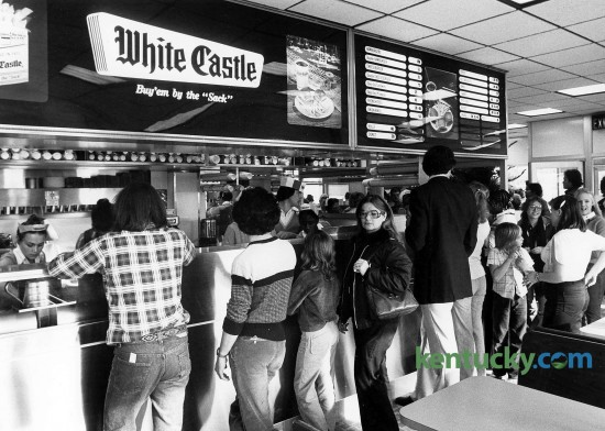 Crowds lined up inside and stretched out the door at the opening of Lexington's first White Castle restaurant Dec. 1, 1980. One day shortly after it's opening, this location at New Circle and Bryan Station roads sold 47,000 hamburgers - at 26 cents a piece. Almost exactly one year later, a second location opened on East Reynolds Road. Photo by Charles Bertram | staff