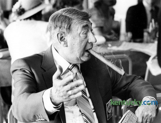 ABC Sports broadcaster Howard Cosell smokes a cigar while waiting for the Kentucky Derby to start May 5, 1984. The legendary sportscaster worked 11 consecutive Derby's (1975-85) during his 40year broadcasting career. Herald-Leader file photo