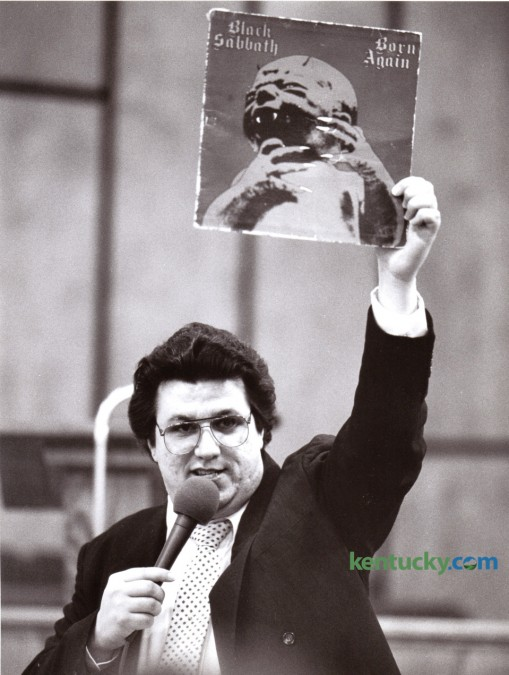 "Michael Watson, an evangelist from Buhl, Ala., held up a Black Sabbath album January 10, 1986 during a revival at the Winchester Church of God Cathedral entitled ""Rock of the 80's - A Christian Perspective on Rock Music."" The revival also featured the burning of rock records and tapes.  Photo by David Perry 