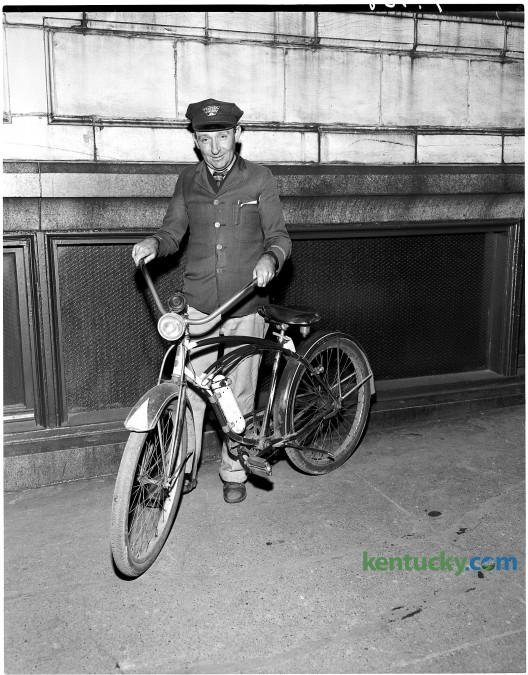 Western Union Telegraph Company messenger Billy Bush and his bicycle, January 1951. Bush served as a company messenger for over 30 years. Herald-Leader archive photo