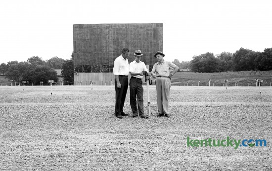 "From left, J.M. Mahaffey, Bob Perkins and M.C. Hughes inspect a speaker unit Aug. 12, 1961 at the new Southland 68 Drive-In Theater on Harrodsburg Road just across the Fayette, Jessamine Co. line. In the background is the backdrop for what is billed as the ""world's largest drive0in movie screen"". The drive-in closed in the mid-1980's and is now Bellerive Plaza, whcih includes a Kroger. Herald-Leader archive photo."