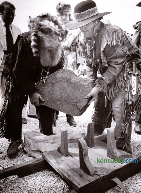 Pioneer Jim Williams, left, and an unidentified assistant, place the 200-pound cornerstone for the Lexington Civic Center on a wooden carrier during Lexington's Bicentennial Celebration Saturday June 14, 1975. The cornerstone came from the John Hancock House in Lexington, Massachusetts and was transported by Williams from there in a horse-drawn covered wagon. Lexington celebrated it's 200th birthday with a three-day festival which included a flag-raising, a parade, the cornerstone dedication, six stages of music and a prayer service. Photo by Ron Garrison | Staff
