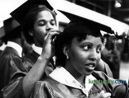 Felix Weathers adjusts Darlene Thornton's cap prior to the processional for the Bryan Station High School graduation May 30, 1981 at Rupp Arena. Bryan Station, Henry Clay and Paul Laurence Dunbar high schools celebrate the 2015 graduating class on May 31. Photo by David Perry | staff