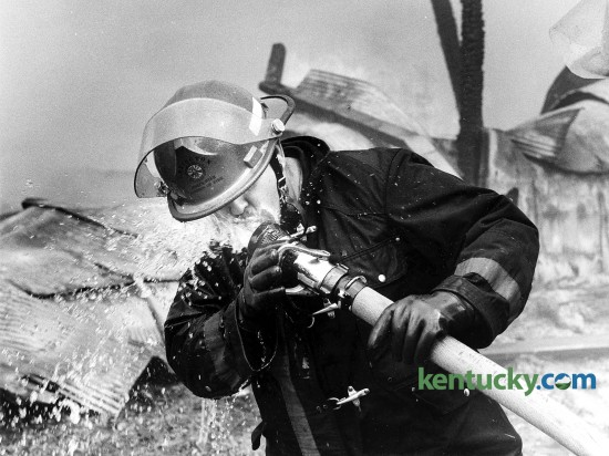 Lexington firefighter Billy Morgan takes a water break May 6, 1986 while fighting a tobacco warehouse fire on Virginia Ave. Photo by Frank Anderson | staff