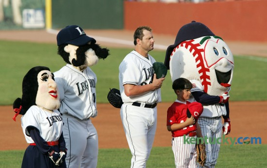 "Lexington Legends starting pitcher Roger Clemens was joined by the Legends mascots and 8-year-old Jonah Dixon, a member of the Southwest Lexington Reds, for the National Anthem before he pitched June 06, 2006. Clemens, nicknamed ""Rocket"", chose to come out of retirement and signed with the Houston Astros. He was in Lexington for his first rehab start which was before a record crowd of 9,222 at Applebee's Park, an overflow media contingent, a national TV audience and his son Koby playing third base. At 7:09 p.m. -- after a nearly weeklong buildup, and after the public address system had played Elton John's Rocket Man -- the 43-year-old Clemens, maybe the finest pitcher the game has ever known, took the mound for what he called ""Step one."" Sixty minutes and 62 pitches later it was over. Clemens pitched three innings, and allowed three hits including a home run to Lake County's Johnny Drennen. He also struck out six and hit a batter. ""It felt great,"" Clemens, sporting a Texas Longhorns cap, said afterward. Clemens ended up playing for three more seasons and retired again in 2007. Photo by Charles Bertram 