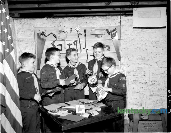 Cub Scout Pack Number 5 of Woodland Christian Church plans a potluck supper, Feb. 1951. From left, Joe White, Paul Reed, Tommy Treumpy, Fred Smith and A. C. Stagg Jr. published 2/21/1951. Herald-Leader archive photo