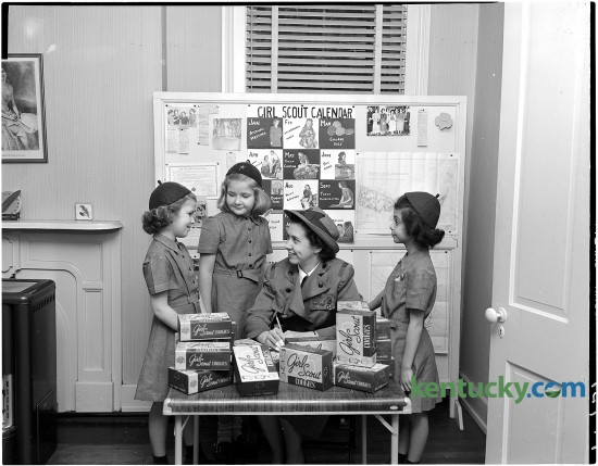 Girl Scouts get ready for cookie sale, Feb. 1951. From left, Mary Stewart McCabe, Tay Maxon, Mrs. Richard C. Jett and Grace Miller. Published in the Herald-Leader February 25, 1951. Herald-Leader Archive Photo