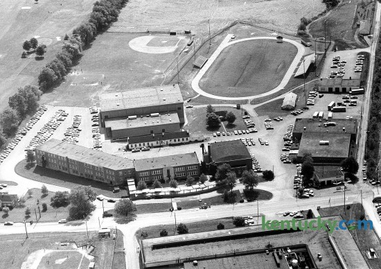 Madison Central High School in Richmond, March, 1977. Around the time of this picture, the school opened it's new gym, located just under the baseball field. The building on the right is the school's vocational facility. Photo by John C. Wyatt | staff  Red House Road