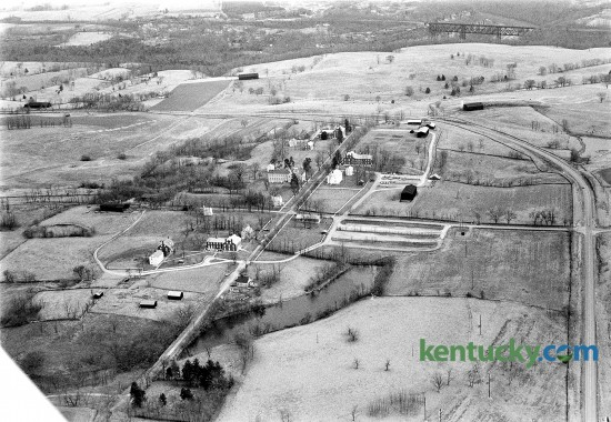 Aerial picture of Shaker Village of Pleasant Hill in Harrodsburg, Jan. 23, 1973. It is America's largest restored Shaker village. In the upper right corner is High Bridge spanning over the Kentucky River. U.S. 68 (Lexington Road) runs up the right side of the picture and curves around the Shaker property. Herald-Leader archive photo