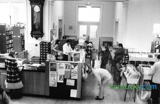 The check-out desk at the Lexington's Public Library's main branch on West Second Street, Feb. 6, 1982. The library moved to its current Central Library location at 140 East Main Street in April, 1989. The new $9.4 million branch was 110,400 square feet of space, compared with the old library's 18,000 square feet. The old location, which was built with a 1902 grant from millionaire-philanthropist Andrew Carnegie, is now the Carnegie Center for Literacy and Learning. Photo by Ron Garrison | staff