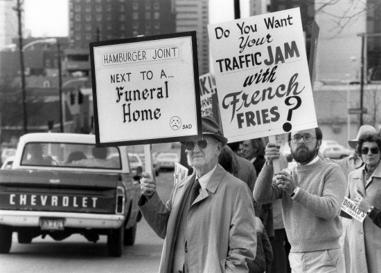 A group including Lon Rogers, left, held up signs as they protested the building of a new McDonalds at 473 Main St. near Forest Ave. in Lexington, Ky., on April 4, 1983. The restaurant ended up being built but without a drive-thru window. McDonalds later moved to another location and Cielito Lindo Mexican restaurant moved into the old building. The building was torn down a few years ago. Photo by Charles Bertram | Staff