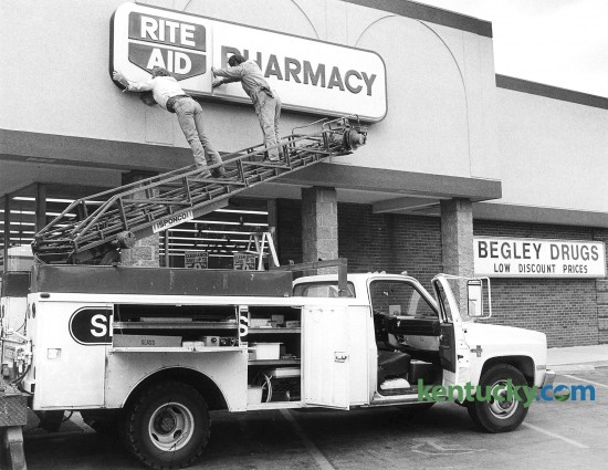 Red McDaniel and Paul Fletcher, employees of Smithers Sign Co., put up a new Rite Aid Pharmacy sign April 28, 1988 on the former Begley drugstore in Imperial Shopping Center on Waller Avenue in Lexington. Rite Aid, at the time the nation's largest drugstore company, bought Begley's for $18.5 million in 1988. It won a nine-week takeover battle against SupeRx of Arizona, Georgia and Alabama Corp. Begley, which was based in Richmond had 43 drugstores in Kentucky and 140 dry-cleaning outlets in 10 states under the name Big B One Hour Cleaners. The Begley Co. once employed 1,400 people. Photo by Michael Malone | staff